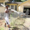 Kingdom Life Academy student Antione Neal, 18, helps remove large tree branches from the yard of a home on Martin  Luther King Jr. Blvd. in Tyler Saturday morning June 11, 2016. The school has partnered with the City of Tyler to assist in yard work those who cannot do it themselves such as the elderly and disabled. <br /> <br /> (Sarah A. Miller/Tyler Morning Telegraph)