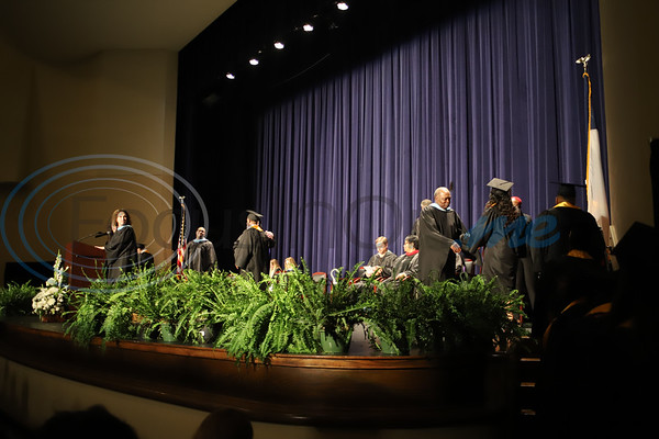 Graduates walk across the stage at Caldwell Auditorium during the Alvin V. Anderson RISE Academy graduation ceremony. Sarah Perez/Freelance