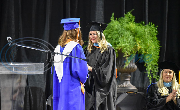 UT Tyler University Academy Director of the Tyler campus Aimee Dennis congratulates Tyler campus Valedictorian Abigail Campbell at the Academy's inaugural graduation on Saturday, June 1 at the Herrington Patriot Center. The Academy is comprised of 3 campuses including Longview, Palestine and Tyler and had a total of 42 graduates. (Jessica T. Payne/Tyler Morning Telegraph)