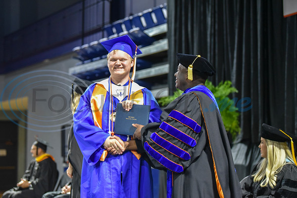 UT Tyler University Academy student Isaac Rodgerson, Salutatorian of the Tyler campus, receives his diploma during the inaugural graduation for the Academy. The graduation took place at the Herrington Patriot Center on Saturday, June 1. (Jessica T. Payne/Tyler Morning Telegraph)
