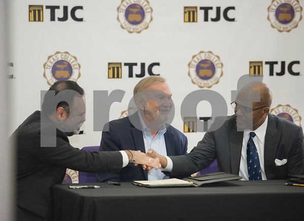 Dr. Juan E. Mejia, President, Branch Locations and TJC District Provost, and Dr. Dwight J. Fennell, President of Texas College, shake hands after signing an articulation agreement at the McKinney Hall Connector on Texas College's campus on Friday June 15, 2018.   (Sarah A. Miller/Tyler Morning Telegraph)