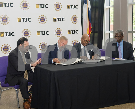 Dr. Michael Metke, Chancellor for the College District of TJC and Chief Executive Officer and Dr. Dwight J. Fennell, President of Texas College, sign an articulation agreement at the McKinney Hall Connector on Texas College's campus on Friday June 15, 2018.   (Sarah A. Miller/Tyler Morning Telegraph)