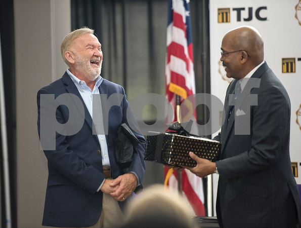 Dr. Michael Metke, Chancellor for the College District of TJC and Chief Executive Officer and Dr. Dwight J. Fennell, President of Texas College, exchange gifts after signing an articulation agreement at the McKinney Hall Connector on Texas College's campus on Friday June 15, 2018.   (Sarah A. Miller/Tyler Morning Telegraph)