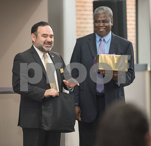 Dr. Juan E. Mejia, President, Branch Locations and TJC District Provost and Dr. Stephen Jones, Vice President for Academic Affairs at Texas College exchange gifts after signing an articulation agreement at the McKinney Hall Connector on Texas College's campus on Friday June 15, 2018.   (Sarah A. Miller/Tyler Morning Telegraph)
