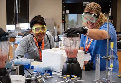 New Summerfield High School student Juan Aguilar, 17, watches as his partner Allee Parker, 16, of Brownsboro High School, uses a blender in the process of extracting l-lactade dehydrogenase from tissue of a cow's heart during Pre-Med Academy Camp at the University of Texas at Tyler on Wednesday June 19, 2019.  (Sarah A. Miller/Tyler Morning Telegraph)