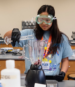 Ridgeport High School student Molina Blanchard, 17, pours a buffer solution into a blender with tissue from a cow's heart during Pre-Med Academy Camp at the University of Texas at Tyler on Wednesday June 19, 2019.  (Sarah A. Miller/Tyler Morning Telegraph)