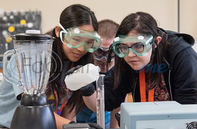 Ridgeport High School student Molina Blanchard, 17, UT Tyler student assistant Michael King and UT Tyler University Academy student Nicole Malmstrom, 17, watch closely as they measure a buffer solution during Pre-Med Academy Camp at the University of Texas at Tyler on Wednesday June 19, 2019.  (Sarah A. Miller/Tyler Morning Telegraph)