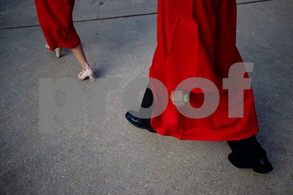 Graduates walk from Mike Carter Field to Trinity Mother Frances Rose Stadium for Robert E. Lee High School's graduation ceremony in Tyler, Texas, on Friday, June 2, 2017. Thousands of friends and family members came to see the hundreds of seniors walk the stage for graduation. (Chelsea Purgahn/Tyler Morning Telegraph)