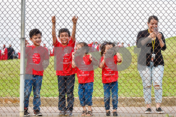 From left to right, Isaac Hernandez, 5, Aiden Gandarilla, 8, Skylah Blissett, 3, Evelyn Hernandez, 7, and Zoraida Bautista cheer for the seniors during Robert E. Lee High School's graduation ceremony at Trinity Mother Frances Rose Stadium in Tyler, Texas, on Friday, June 2, 2017. Thousands of friends and family members came to see the hundreds of seniors walk the stage for graduation. (Chelsea Purgahn/Tyler Morning Telegraph)