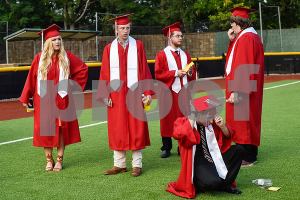 Graduates wait for Robert E. Lee High School's graduation ceremony to begin at Mike Carter Field in Tyler, Texas, on Friday, June 2, 2017. Thousands of friends and family members came to see the hundreds of seniors walk the stage for graduation. (Chelsea Purgahn/Tyler Morning Telegraph)