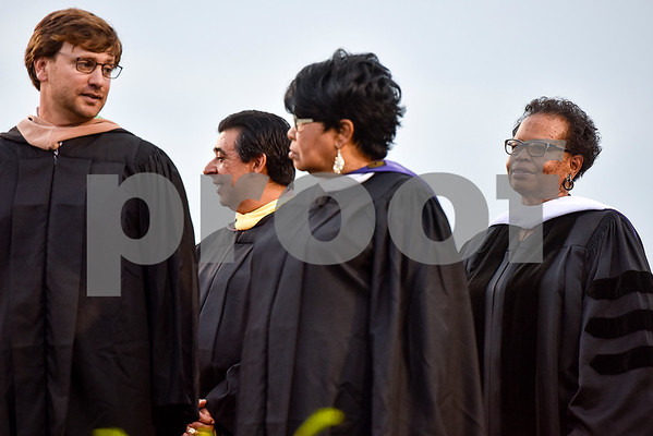 Rev. Orenthia Mason, far right, stands on stage with others during Robert E. Lee High School's graduation ceremony at Trinity Mother Frances Rose Stadium in Tyler, Texas, on Friday, June 2, 2017. Thousands of friends and family members came to see the hundreds of seniors walk the stage for graduation. (Chelsea Purgahn/Tyler Morning Telegraph)