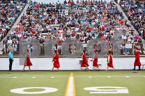 Graduates walk to their seats during Robert E. Lee High School's graduation ceremony at Trinity Mother Frances Rose Stadium in Tyler, Texas, on Friday, June 2, 2017. Thousands of friends and family members came to see the hundreds of seniors walk the stage for graduation. (Chelsea Purgahn/Tyler Morning Telegraph)