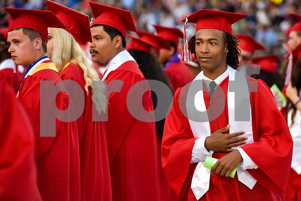 Ashtian Tyrrell Horton walks to his seat during Robert E. Lee High School's graduation ceremony at Trinity Mother Frances Rose Stadium in Tyler, Texas, on Friday, June 2, 2017. Thousands of friends and family members came to see the hundreds of seniors walk the stage for graduation. (Chelsea Purgahn/Tyler Morning Telegraph)
