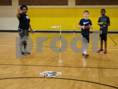 Instructor Tamika Hamlett instructs students John Jordan, 9, and Jamal Logan, 10, as they fly drones through an obstacle course during Drone Adventures, a summer camp held at Tyler Junior College on Wednesday June 6, 2018. Drone Adventures will be held again from July 16-20.  (Sarah A. Miller/Tyler Morning Telegraph)