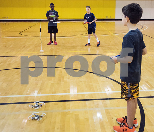 Jamal Logan, 10, John Jordan, 9, and Chuck Weber, 8, fly drones through an obstacle course during Drone Adventures, a summer camp held at Tyler Junior College on Wednesday June 6, 2018. Drone Adventures will be held again from July 16-20.  (Sarah A. Miller/Tyler Morning Telegraph)