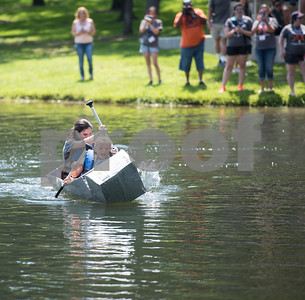 UT-Tyler students Hannah McGuinnis and Hillary Crist race a cardboard boat at The University of Texas at Tyler Thursday June 9, 2016. UT-Tyler is hosting the 2016 American Society of Civil Engineering Concrete Canoe National Competition. Collegiate teams build canoes with concrete and are judged in four categories: technical design report, oral design presentation, canoe final product and racing.   (Sarah A. Miller/Tyler Morning Telegraph)