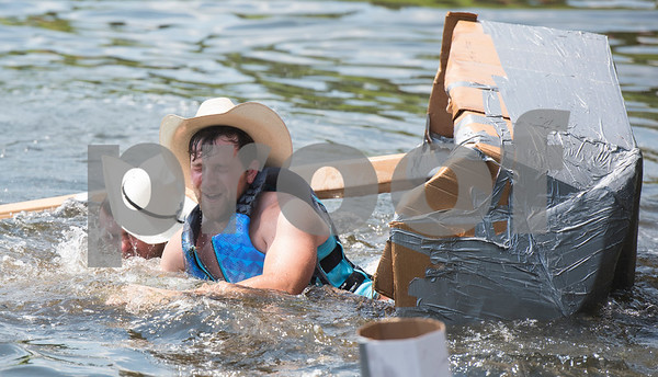 University of Maryland students John McAninley and Rob Martin are tosses overboard as their cardboard boat sinks during a race at The University of Texas at Tyler Thursday June 9, 2016. UT-Tyler is hosting the 2016 American Society of Civil Engineering Concrete Canoe National Competition. Collegiate teams build canoes with concrete and are judged in four categories: technical design report, oral design presentation, canoe final product and racing.   (Sarah A. Miller/Tyler Morning Telegraph)