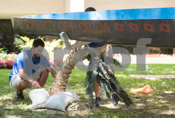Kevin Carabeo of the University of Florida works on his concrete canoe at The University of Texas at Tyler Thursday June 9, 2016. UT-Tyler is hosting the 2016 American Society of Civil Engineering Concrete Canoe National Competition. Collegiate teams build canoes with concrete and are judged in four categories: technical design report, oral design presentation, canoe final product and racing.   (Sarah A. Miller/Tyler Morning Telegraph)