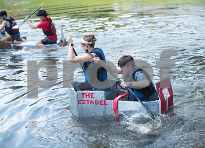 The Citadel students Carli Cline and Laura Russo race a cardboard boat at The University of Texas at Tyler Thursday June 9, 2016. UT-Tyler is hosting the 2016 American Society of Civil Engineering Concrete Canoe National Competition. Collegiate teams build canoes with concrete and are judged in four categories: technical design report, oral design presentation, canoe final product and racing.   (Sarah A. Miller/Tyler Morning Telegraph)