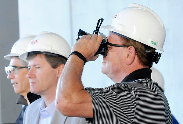 Don Knight | The Herald Bulletin<br /> Chairman of the Board of Works David Eicks looks through a virtul reality headset during a tour of the new Purdue Polytechnic Institute project on Thursday. Purdue University has signed a 15-year lease for academic space in the building.