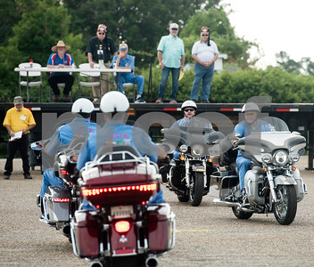 Judges watch the Hella motor patrol from Dallas competes during the Texas Shriner Association convention held in Tyler at Harvey Convention Center on Friday June 8, 2018.  (Sarah A. Miller/Tyler Morning Telegraph)