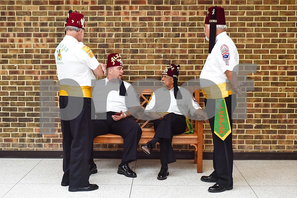 San Antonio shriner members Bobby Hunt, Robert Norman, Art Loera and Joe Garcia chat during the Shriners Convention at Harvey Convention Center in Tyler, Texas, on Friday, June 8, 2018. (Chelsea Purgahn/Tyler Morning Telegraph)