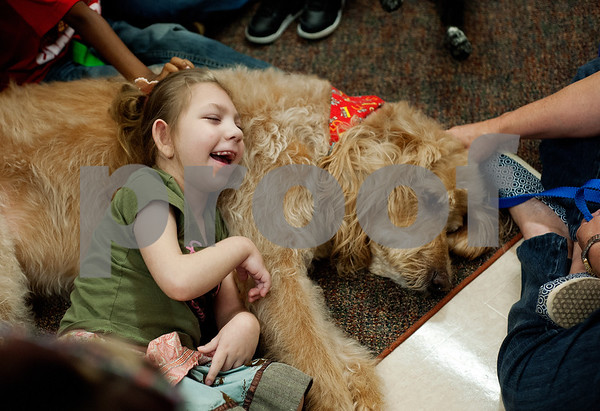 photo by Sarah A. Miller/Tyler Morning Telegraph  Boshears student Hayleigh Danielson, 5, takes a break from her wheelchair to cuddle with Therapet dog Murray during class Thursday June 26, 2014 at the school in Tyler. Therapet Animal Assisted Therapy partners with the Wayne D. Boshears Center for Exceptional Programs by bringing its animals to the school and working with the students who have varying special needs.