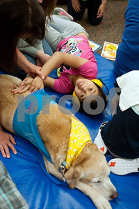 photo by Sarah A. Miller/Tyler Morning Telegraph   Boshears student Angeline Moreno, 10, pets Therapet dog Bonnie during class Thursday June 26, 2014 at the school in Tyler. Therapet Animal Assisted Therapy partners with the Wayne D. Boshears Center for Exceptional Programs by bringing its animals to the school and working with the students who have varying special needs.
