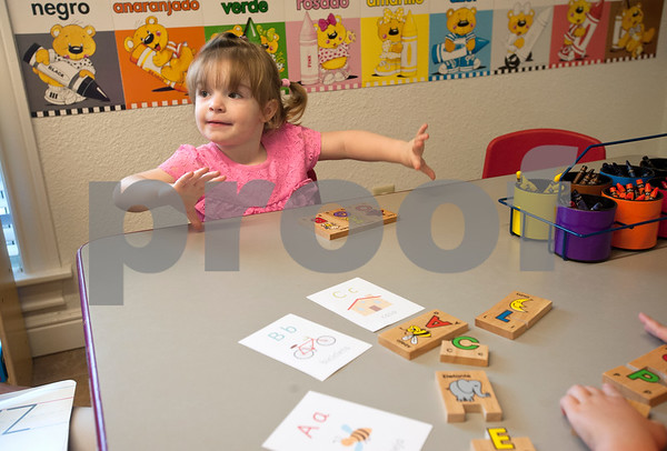 Student Emma Vickers, 3, matches words and letters in Spanish at Early Steps Bilingual Academy in Tyler Tuesday July 7, 2015. Early Steps Bilingual Academy is a Spanish immersion day care for children ages 18 months to five years old. Owners Mireya Hicks and Marsha Trifilio use a variety of activities to teach English-speaking to learn to speak Spanish.  (photo by Sarah A. Miller/Tyler Morning Telegraph)