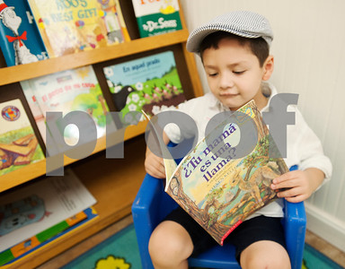 Students Nolan Newberry, 3, reads a book in Spanish at Early Steps Bilingual Academy in Tyler Tuesday July 7, 2015. Early Steps Bilingual Academy is a Spanish immersion day care for children ages 18 months to five years old. Owners Mireya Hicks and Marsha Trifilio use a variety of activities to teach English-speaking to learn to speak Spanish.  (photo by Sarah A. Miller/Tyler Morning Telegraph)