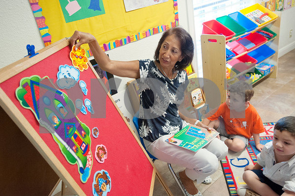 Mireya Hicks teaches her students a nursery rhyme in Spanish at Early Steps Bilingual Academy in Tyler Tuesday July 7, 2015. Early Steps Bilingual Academy is a Spanish immersion day care for children ages 18 months to five years old. Owners Mireya Hicks and Marsha Trifilio use a variety of activities to teach English-speaking to learn to speak Spanish.  (photo by Sarah A. Miller/Tyler Morning Telegraph)