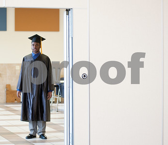 photo by Sarah A. Miller/Tyler Morning Telegraph  Chinedu Ezeigwe Jr., or Junior as he is more commonly called, waits to enter the cafeteria at Wayne D. Boshears Center for Exceptional Programs for his graduation Wednesday. Ezeigwe was this year's only graduate.  This Tyler ISD school serves students with special needs of all ages. Ezeigwe, age 22, is autistic and has a great passion for music. He will perform during his ceremony.