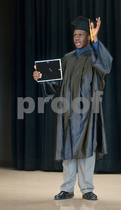 photo by Sarah A. Miller/Tyler Morning Telegraph  Chinedu Ezeigwe Jr., or Junior as he is more commonly called, waves to the audience of family, friends and teachers after receiving his diploma during graduation  at Wayne D. Boshears Center for Exceptional Programs Wednesday. Ezeigwe was this year's only graduate.  This Tyler ISD school serves students with special needs of all ages. Ezeigwe, age 22, is autistic and has a great passion for music. He will perform during his ceremony.