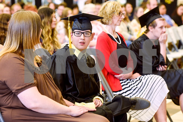 Pablo Ponce Jr. looks towards the camera during a graduation ceremony at Wayne D. Boshears Center for Exceptional Programs School in Tyler, Texas, on Thursday, July 19, 2018. (Chelsea Purgahn/Tyler Morning Telegraph)
