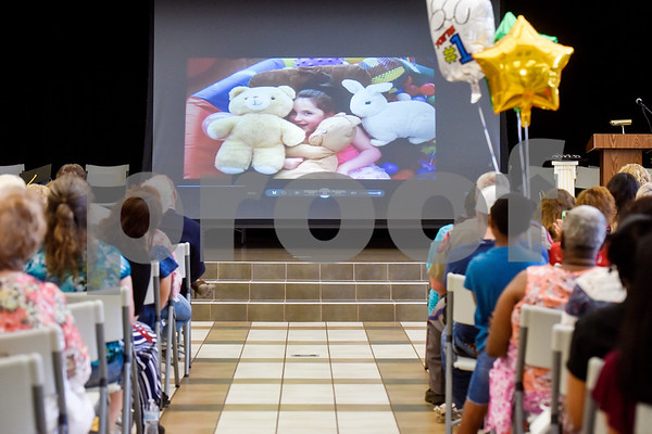 People watch a slideshow during a graduation ceremony at Wayne D. Boshears Center for Exceptional Programs School in Tyler, Texas, on Thursday, July 19, 2018. (Chelsea Purgahn/Tyler Morning Telegraph)