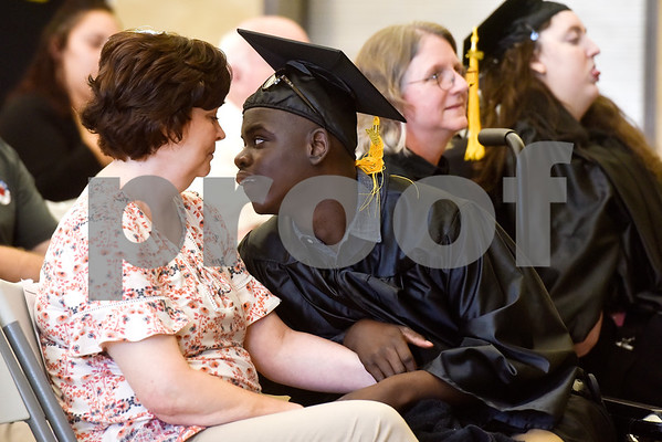 Diana Garen and Bryan Ashton Jackson-Pinke look at one another during a graduation ceremony at Wayne D. Boshears Center for Exceptional Programs School in Tyler, Texas, on Thursday, July 19, 2018. (Chelsea Purgahn/Tyler Morning Telegraph)
