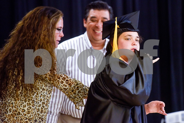 Samantha Lynnann Carper, right, walks across the stage during a graduation ceremony at Wayne D. Boshears Center for Exceptional Programs School in Tyler, Texas, on Thursday, July 19, 2018. (Chelsea Purgahn/Tyler Morning Telegraph)