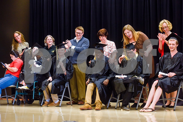 Boshears graduates sit on stage during a graduation ceremony at Wayne D. Boshears Center for Exceptional Programs School in Tyler, Texas, on Thursday, July 19, 2018. (Chelsea Purgahn/Tyler Morning Telegraph)
