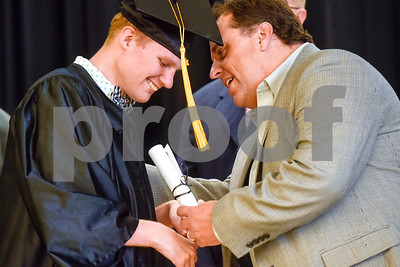 Zachary Samuel David Dodds smiles as Dr. Marty Crawford hands him his diploma during a graduation ceremony at Wayne D. Boshears Center for Exceptional Programs School in Tyler, Texas, on Thursday, July 19, 2018. (Chelsea Purgahn/Tyler Morning Telegraph)