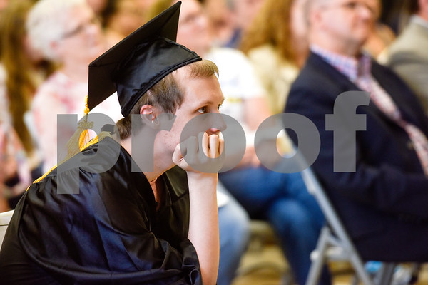 Cody Lee Vineyard watches a slideshow during a graduation ceremony at Wayne D. Boshears Center for Exceptional Programs School in Tyler, Texas, on Thursday, July 19, 2018. (Chelsea Purgahn/Tyler Morning Telegraph)