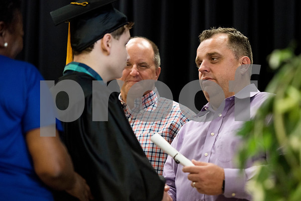 Tyler ISD superintendent Dr. Marty Crawford shakes Ethan Romines' hand has he gives him his diploma during a graduation ceremony for Wayne D. Boshears Center for Exceptional Programs at Wayne D. Boshears Center in Tyler, Texas, on Thursday, July 20, 2017. Five students graduated from the program. (Chelsea Purgahn/Tyler Morning Telegraph)
