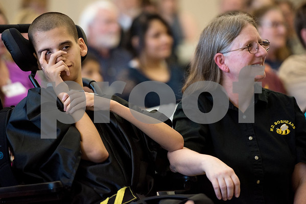 Joshua Davis and Brenda Corley watch Davis' tribute video during a graduation ceremony for Wayne D. Boshears Center for Exceptional Programs at Wayne D. Boshears Center in Tyler, Texas, on Thursday, July 20, 2017. Five students graduated from the program. (Chelsea Purgahn/Tyler Morning Telegraph)
