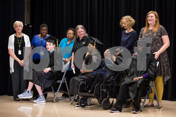 Boshears students sit on the stage with staff after they received their diplomas during a graduation ceremony for Wayne D. Boshears Center for Exceptional Programs at Wayne D. Boshears Center in Tyler, Texas, on Thursday, July 20, 2017. Five students graduated from the program. (Chelsea Purgahn/Tyler Morning Telegraph)
