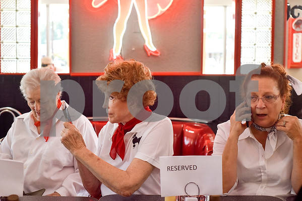 Sharon Roddy sits as Misti Ford takes a picture on her phone and Lindasue Ageyitowadi Pickle-Hill talks on her phone during a Ms. Texas Senior Classic Pageant lunch at Whataburger in Tyler, Texas, on Friday, July 21, 2017. The pageant will take place in September. (Chelsea Purgahn/Tyler Morning Telegraph)
