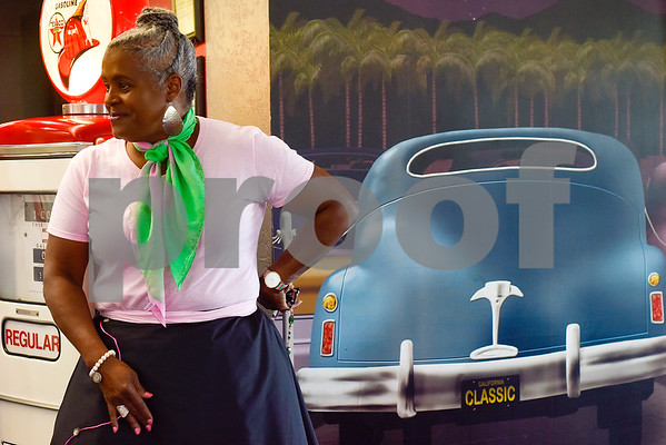 Charlotte Adams-Graves stands next to a mural of a classic car during a Ms. Texas Senior Classic Pageant lunch at Whataburger in Tyler, Texas, on Friday, July 21, 2017. The pageant will take place in September. (Chelsea Purgahn/Tyler Morning Telegraph)