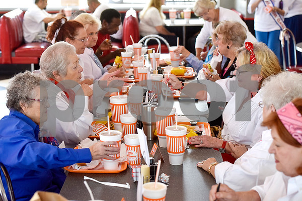 Women chat and eat during a Ms. Texas Senior Classic Pageant lunch at Whataburger in Tyler, Texas, on Friday, July 21, 2017. The pageant will take place in September. (Chelsea Purgahn/Tyler Morning Telegraph)