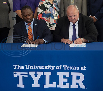 """Dr. Michael Tidwell, President of The University of Texas at Tyler and Dr. William Michael """"Mike"""" Smith, President of Jacksonville College, sign a memorandum of understanding between the schools that will define the requirements to transfer from JC to UT Tyler without loss of credit or recognition of approved courses.  (Sarah A. Miller/Tyler Morning Telegraph)"""