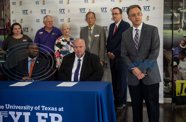 "Dr. Amir Mirmiran, Provost of The University of Texas at Tyler, speaks before Dr. Michael Tidwell, President of The University of Texas at Tyler and Dr. William Michael ""Mike"" Smith, President of Jacksonville College, sign a memorandum of understanding between the schools that will define the requirements to transfer from JC to UT Tyler without loss of credit or recognition of approved courses.  (Sarah A. Miller/Tyler Morning Telegraph)"