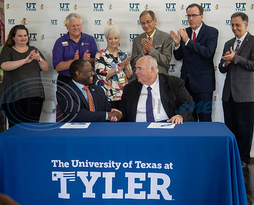 "Dr. Michael Tidwell, President of The University of Texas at Tyler and Dr. William Michael ""Mike"" Smith, President of Jacksonville College, shake hands after a formal signing of a memorandum of understanding between the schools that will define the requirements to transfer from JC to UT Tyler without loss of credit or recognition of approved courses.  (Sarah A. Miller/Tyler Morning Telegraph)"