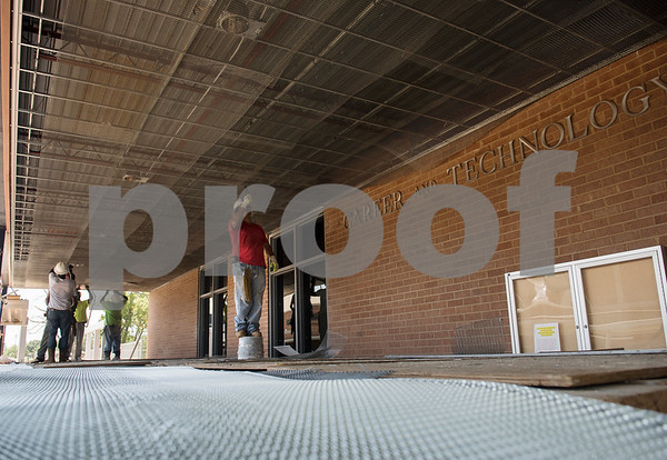 Construction crews remodel the Jacksonville Independent School District Career & Technical Education department building on Tuesday July 24, 2018.  (Sarah A. Miller/Tyler Morning Telegraph)